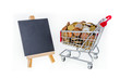 Shopping cart with pennies and black chalkboard to write on. Isolated on white background