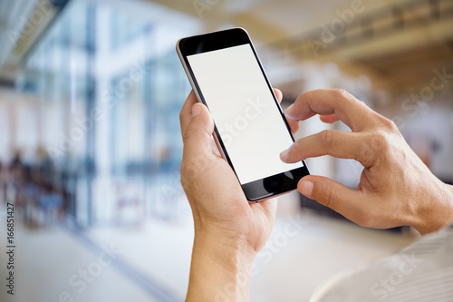 Businessman using Smartphone. Blank screen mobile phone for graphic display montage.