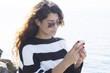 Quadro Girl talking on mobile phone at sea