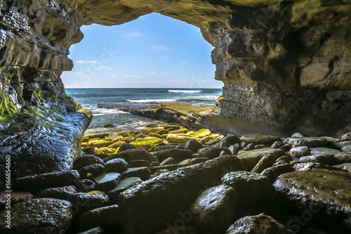 The beautiful rock cave at the sea in La Jolla California at an angle