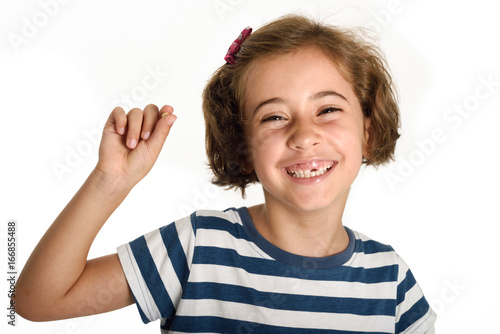 Happy little girl showing her first fallen tooth.