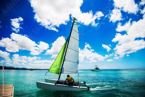 Close up boat sailing on the beautiful sea.