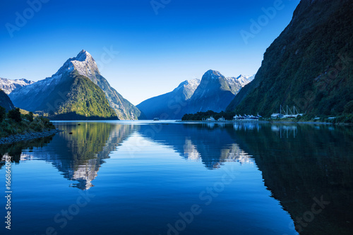 Foto op Canvas Nachtblauw Mitre Peak at Milford Sound in south island, New Zealand in the morning in autumn. The mountian and the reflection i the sea