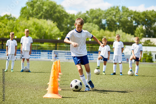 Junior Football Player at Practice - 166865008