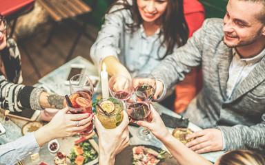 Happy friends enjoying appetizer in american vintage bar