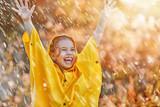 child under autumn rain