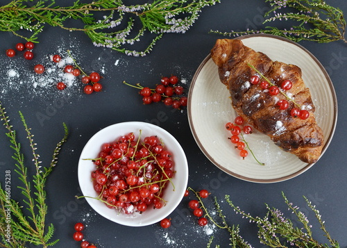 Cup of cappuccino, croissants, redcurrant © milenie