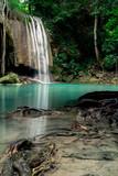 Teal and clear water of the Erawan Waterfall in Kanchanaburi, Thailand.