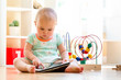 Toddler girl watching a tablet computer