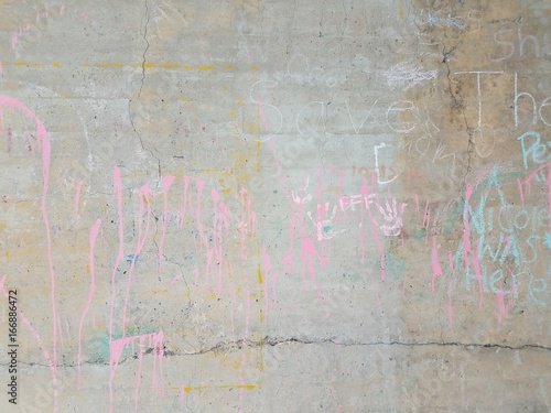 cement wall with chalk writing