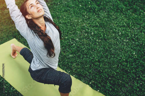 Plakat Portrait of happiness young woman practicing yoga on outdoors.Yoga and relax concept. Beautiful girl practice asana