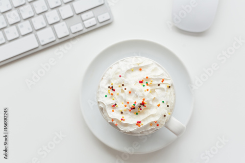 Tasty dessert with colorful sprinkles in porcelain cup Poster