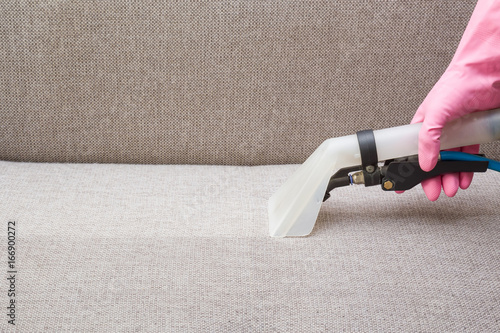 Sofa Chemical Cleaning With Professionally Extraction Method Hand In Rubber Protective Glove Holding Nozzle Of