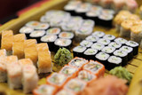 A great dish of traditional Japanese cuisine - sushi in a restaurant - 166920076