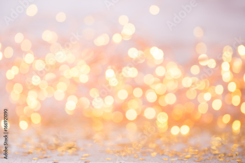 Wall mural Abstract gold bokeh. Christmas and new year theme background.