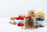 healthy products for breakfast, granola and fresh berries on white table - 166942891