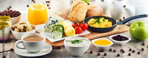 Breakfast served with coffee, cheese, cereals and scrambled eggs - 166949275