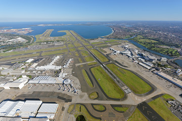 Sydney Airport, looking south-west over the Domestic and International Terminals towards Botany Bay