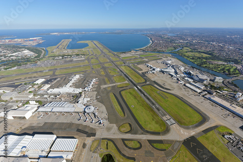 Aluminium Sydney Sydney Airport, looking south-west over the Domestic and International Terminals towards Botany Bay