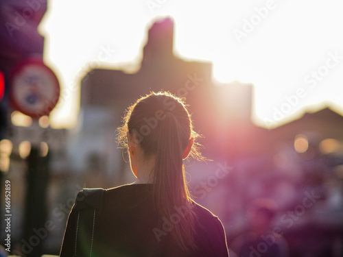 back of japanese business girl in sunset