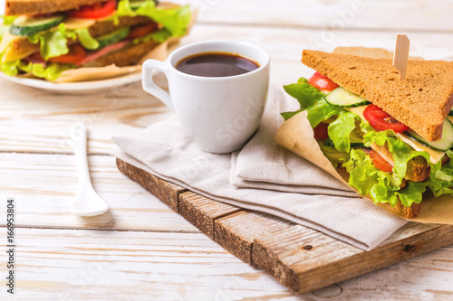 Wall mural Rye bread sandwich with ham, cheese, lettuce and coffee