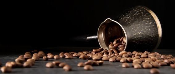 Italian coffee grains in turk. Delicious aromatic drink. Dark ba © naltik