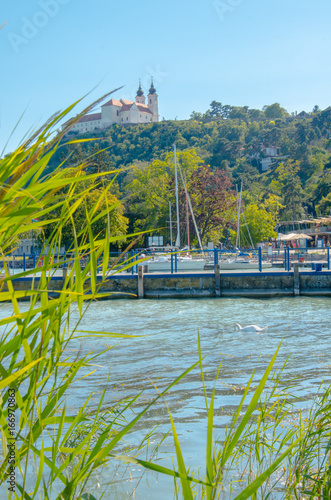 Tihany abbey with harbour Poster