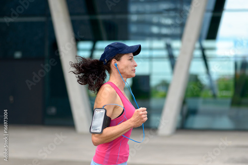 Fit young woman jogging through town