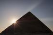 Sun rising behind the Great Pyramid  of Giza.