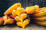 Stacked kayaks on a beach - 166976044