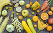 Quadro Composition of yellow vegetables and fruits - banana, corn, lemon, plum, apricot, pepper, zucchini, tomato, asparagus beans, ginger. Healthy food. Top view. Flat lay