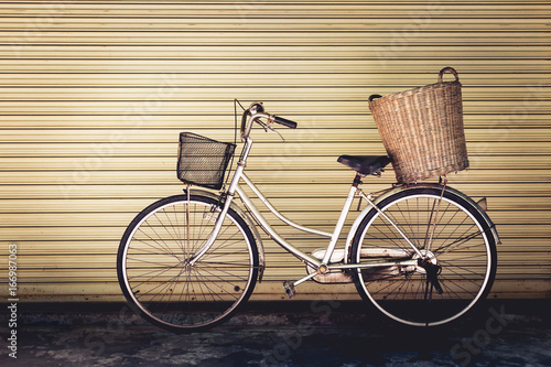 Old bicycle on wall background, vintage style