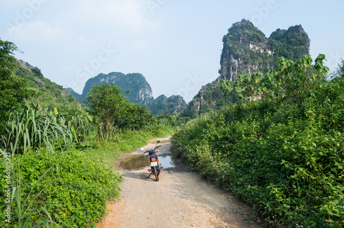 Limestone Landscape with Road and Motorbike, Tam Coc, Vietnam