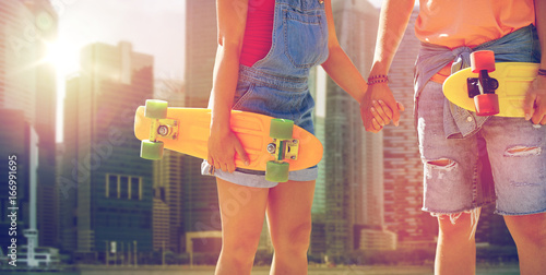Poster close up of young couple with skateboards in city