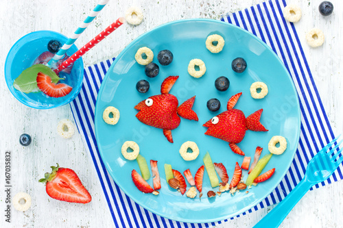 Fun with food - berry fruit fish on plate