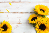 Fototapeta Kwiaty - Yellow Sunflower Bouquet on White Rustic Background © manuta