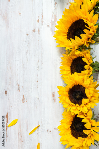 Fototapeta Yellow Sunflower Bouquet on White Rustic Background