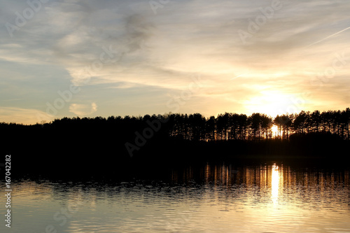 Foto op Canvas Zwart View of the lake in sunset time