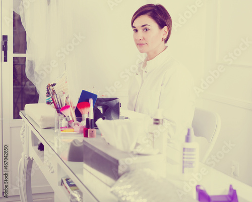 Woman doing nails displaying her workplace