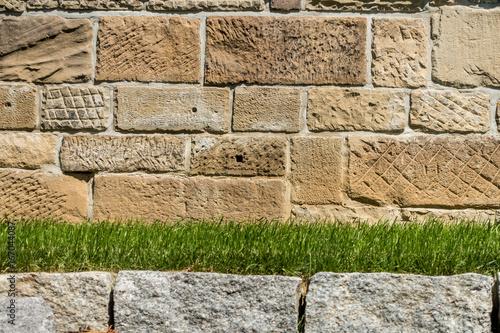 Foto op Canvas Baksteen muur Mauer und Vorgarten