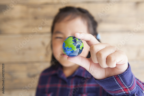 The girl has a miniature earth
