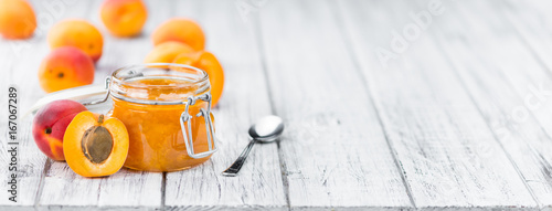 Portion of Apricot Jam on wooden background (selective focus) - 167067289