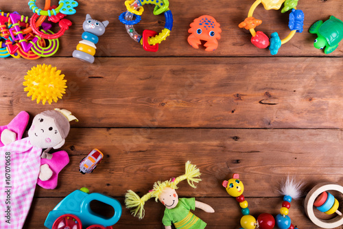 group of baby toys on wooden background with copy space. top view