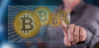 Man touching a bitcoin currency concept on a touch screen