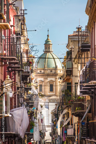 View at the church of San Matteo located in heart of Palermo, Italy, Europe. Traditional Italian medieval city center with typical narrow residential street.