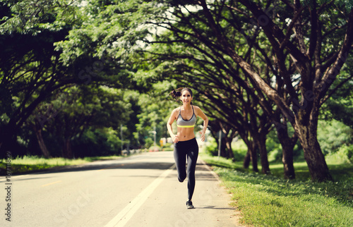 Asian women Jogging in the morning at the park