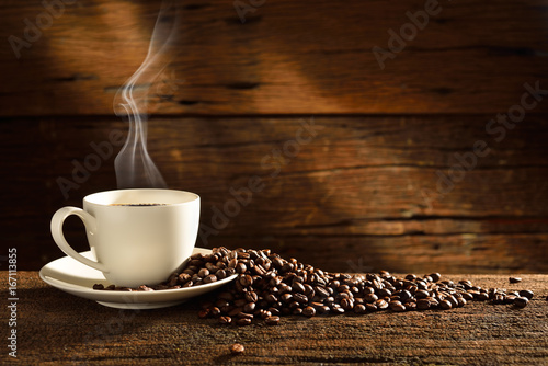 Wall mural Coffee Cup and Beans on Wooden Table