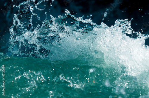 Splash of stormy water in the ocean on a black background