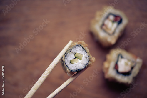 Japanese sushi rolls on a wooden stand. Japanese food.
