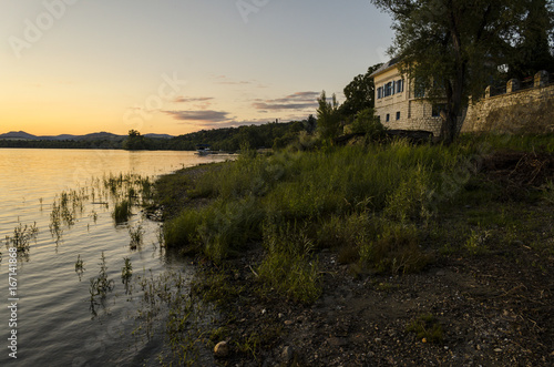 Foto op Canvas Zwart sunset, river view in summer. Colorful landscape summer sunset on the river bank. Sun rays and reflections on water